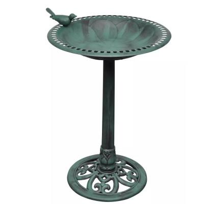 Bain d'oiseau sur pied vert avec oiseau décoratif