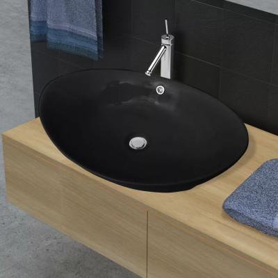 Lavabo ovale en céramique noire de luxe avec trop-plein 59 x 38,5 cm